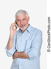 äldre bemanna, användande, rörlig telefonera
