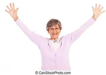 äldre kvinna, havsarm öppnar