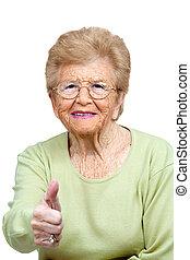 äldre kvinna, visande, tummar, uppe.