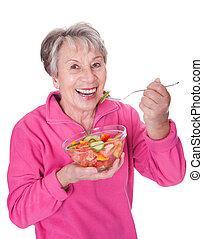 ältere frau, essende, salat