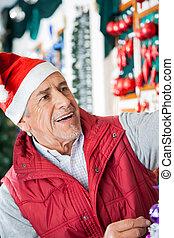 älterer mann, eigentümer, arbeiten, weihnachten, kaufmannsladen