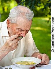 älterer mann, essende