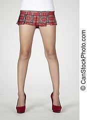 écolière, talons, courte jupe