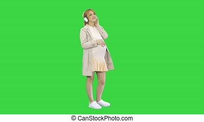 écouteurs, pregnant, séduisant, vert, écran, écoute, chroma...