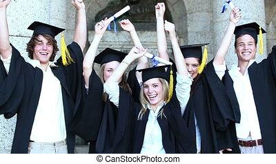 élévation, diplômés, sauter, bras, heureux
