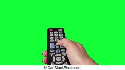 éloigné, écran tv, main femme, vert