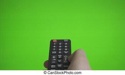éloigné, tv, sur, screen., main, canaux, advertisement., urgent, vert, endroit, mâle, ton