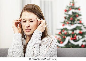 énfasis, niña joven, tiene, navidad, dolor de cabeza