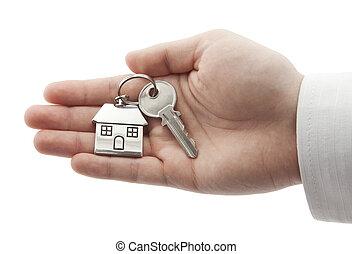épület kulcs, kéz