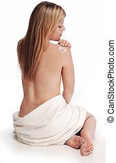 épaule, femme, appliquant lotion
