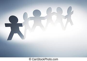 équipe, chaîne papier, tenant mains