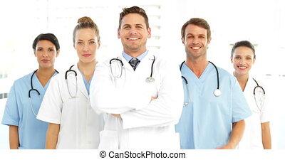 équipe, heureux, crosse, bras, monde médical