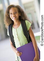 étudiant, debout, dehors, école, tenue, relieur, et, sourire, (selective, focus)