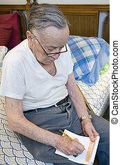 írás, idősebb ember