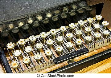 írógép billentyűzet, szög