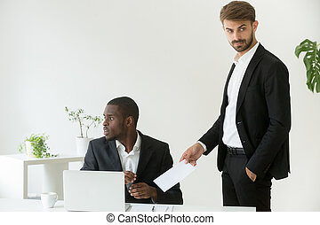 Ð¡aucasian businessman giving bribe to corrupt african partner i