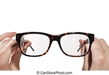 óculos, com, horn-rimmed, em, mãos humanas
