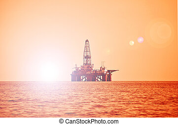 óleo offshore guarnece, durante, pôr do sol, em, mar cáspio