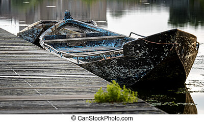 öreg, csónakázik