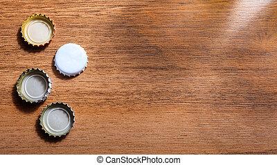 øl, caps, på, af træ, baggrund., top udsigt