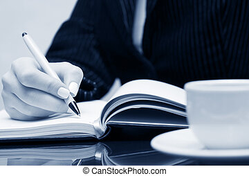 üzletasszony, írás