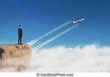 üzletember, repülőgép, kő