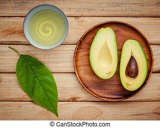 čerstvý, avokádo, s, avokádo, list, a, nafta, dále, dřevěný, grafické pozadí., organický, avokádo, zdravý food, concept.