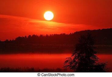 červeň, východ slunce