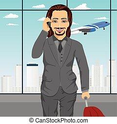 člověk obchodního ducha, mluvící, dále, smartphone, v, letiště, stálý, s, s, zavazadla