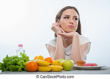 ładny, zdrowy, młody, jadło, wybierając, między, dziewczyna, niezdrowy