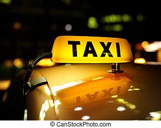 żółta taksówka, znak, w nocy