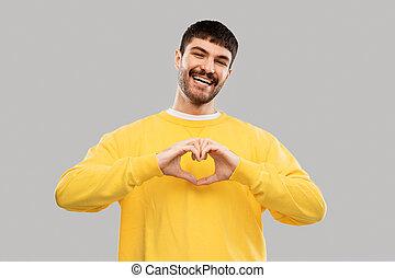 żółty, człowiek, sweatshirt, młody, uśmiechanie się