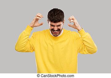 żółty, gniewny, człowiek, szary, sweatshirt, młody, na