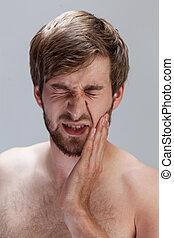 άντραs , πόνος , πονόδοντοs