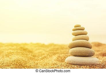 βγάζω τα κουκούτσια , άμμοs , θημωνιά