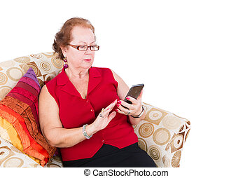 γυναίκα , αυτήν , κάθονται , καναπέs , τηλέφωνο , χρησιμοποιώνταs , αρχαιότερος