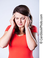 γυναίκα , πονοκέφαλοs