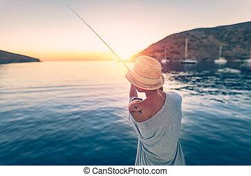 γυναίκα , ψαράs