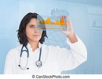 μελαχροινή , γιατρός , looking at , ένα , γραφική παράσταση...