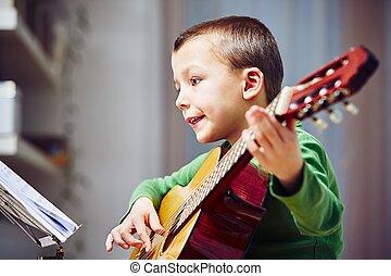 μικρός , κιθαρίστας