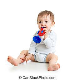 μωρό , παίξιμο , με , μιούζικαλ , άθυρμα , απομονωμένος , αναμμένος αγαθός , φόντο