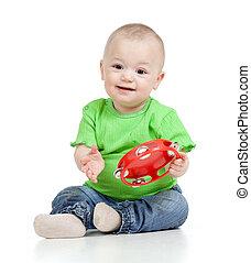 μωρό , παίξιμο , με , μιούζικαλ , toy., απομονωμένος , αναμμένος αγαθός , φόντο