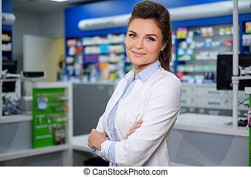 πορτραίτο , από , όμορφος , χαμογελαστά , νέα γυναίκα , φαρμακοποιός , ακάθιστος , μέσα , pharmacy.