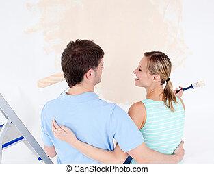 στοργικός , ζευγάρι , ζωγραφική , δωμάτιο