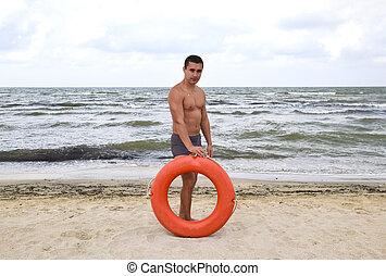 σωσίβιο , παραλία , άντραs