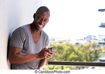 τοίχοs , αφρικανός , εναντίον , τηλέφωνο , αμερικανός , κινητός , κλίση , άντραs , ευτυχισμένος