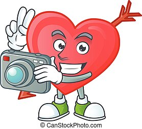 φωτογράφος , φωτογραφηκή μηχανή , χαρακτήρας , αγάπη , βέλος...