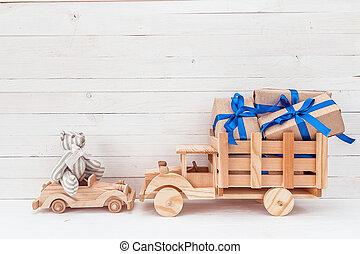 φόντο , με , κρασί , toys:, άγαρμπος άμαξα αυτοκίνητο , με , αρκουδάκι , και , ξύλινος , φορτηγό , με , gifts.