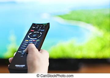 χέρι , με , τηλεοπτικός αμυδρός διακόπτες