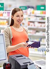 беременная, женщина, with, бумажник, в, касса, в, аптека